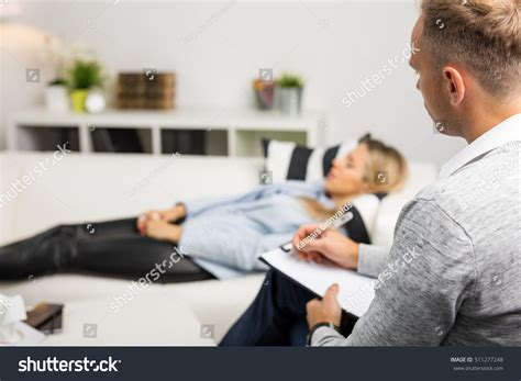 doctors couch woman lying on couch at doctors office stock photo