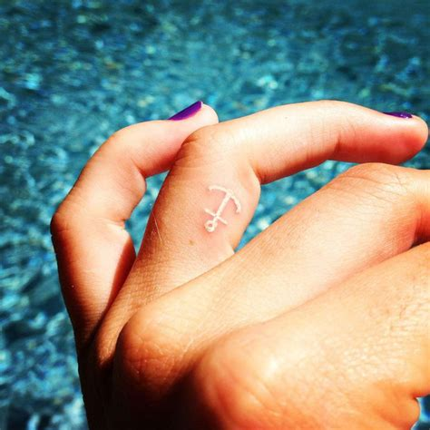 finger tattoo freedom 25 best ideas about navy anchor tattoos on pinterest