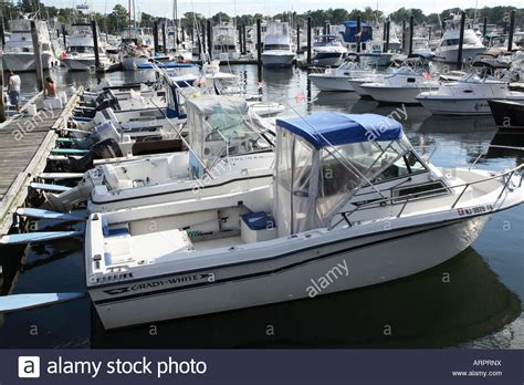 small fishing boats with motor line of small outboard motor fishing boats at dock at the