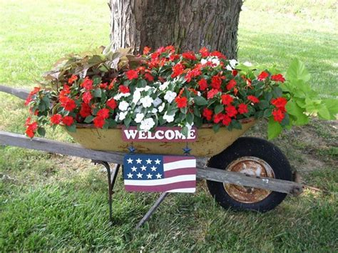 wheelbarrow garden ideas wheelbarrow planter wheelbarrows wagons