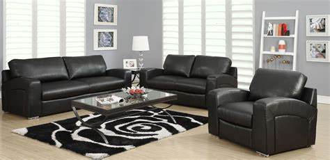 black leather living room black bonded leather match sloped back living room set