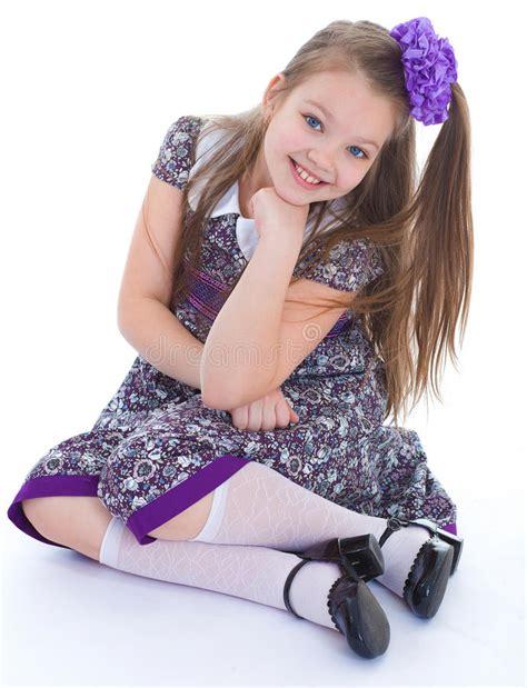 charming little models charming little girl sitting on the floor stock photo