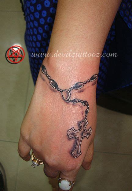 rosary hand tattoo rosary similar placement design tattoos