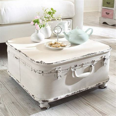 shabby chic i love it take a suitcase or trunk add feet voila a coffee table whitedecor