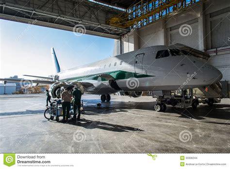 aircraft maintenance hangar alitalia embraer in hangar editorial stock image image