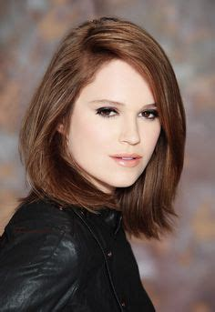 haircut with irregular length adele mid length bob hairstyle with bouncy curls hair