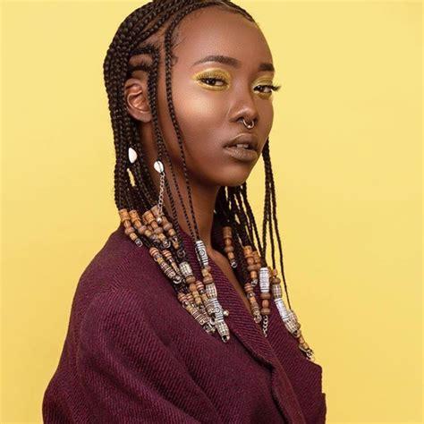 ten tribal hairstyles fashion nigeria braids with beads inspiration essence com