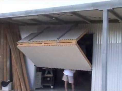 hangar style bifold door   shed  youtube