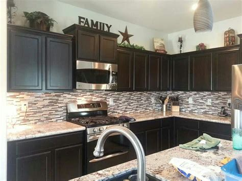 best home kitchen cabinets like the decor on top of cabinets kitchen pinterest