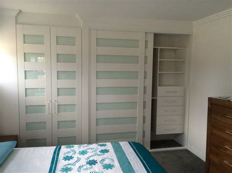 Coastal Closet by Coastal Themed Hinged Sliding Doors Tropical Closet