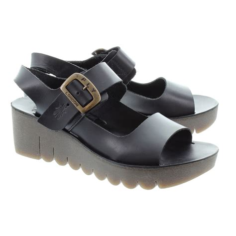 fly black sandals fly yail wedge sandals in black in black