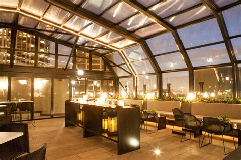 rooftop lincoln hotel j unveils retractable rooftop for bar and