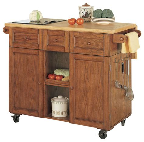 powell medium oak 3 drawer kitchen butler traditional kitchen islands and kitchen carts by