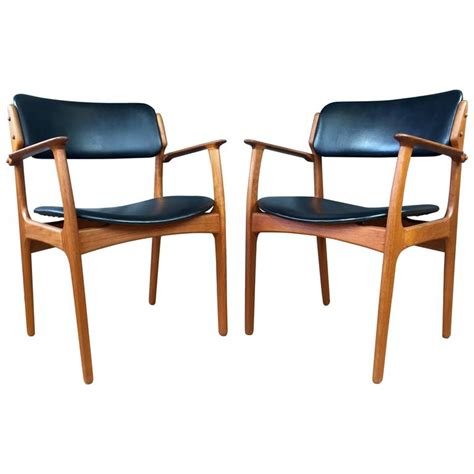 pair of teak model 50 dining chairs by erik buch for