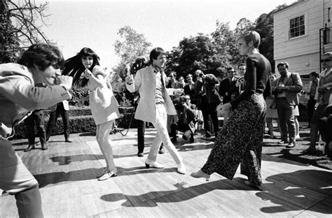 swinging sixties seventies twiggy sonny and cher and others dance at a party in