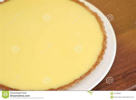 lemon cheesecake pie on yellow background food