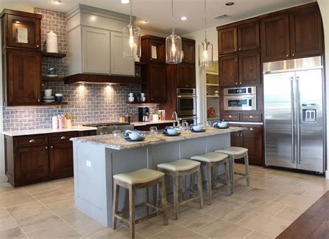 kitchen cabinets with different color island