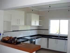 Cozinha americana integrada aos ambientes da sala atrav 233 s de bancada