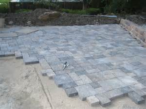 Paver Patio With Retaining Wall Large Tumbled Paver Patio Retaining Wall Being Installed In Arvada A Paver Pathway To