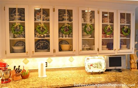 how to decorate kitchen cabinets with glass doors decorate kitchen cabinets with preserved boxwood wreaths