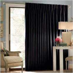 Glass door and window brown curtains stand tripot lamp wall mirror