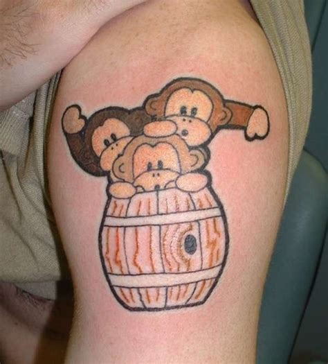 small monkey tattoo three small monkeys in barrel on arm