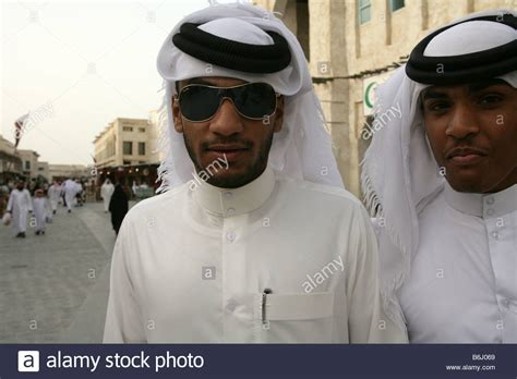 men long hair doha qatar qatari men in traditional attire at the souq waqif market