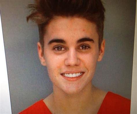 justin bieber s eyes when arrested justin bieber mug shot first image of singer after dui