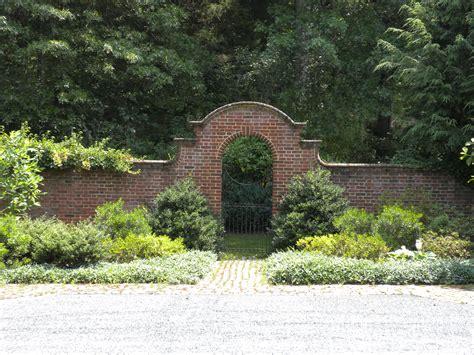 brick garden wall with wrought iron gate johnson craven