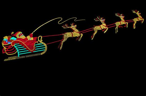 santa sleigh and reindeer photograph by gene sherrill