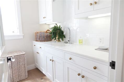 white laundry room cabinets white laundry room cabinets with brushed brass octagon