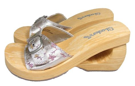 silver skechers slip on wooden effect foam