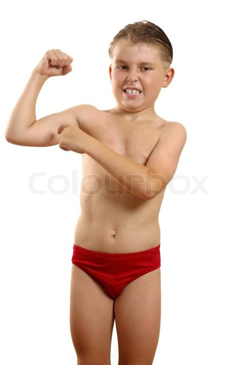 young boys a young boy flexes and points to his muscleswhite
