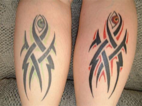 tattoo cross between eyes meaning tribal w eyes tattoo