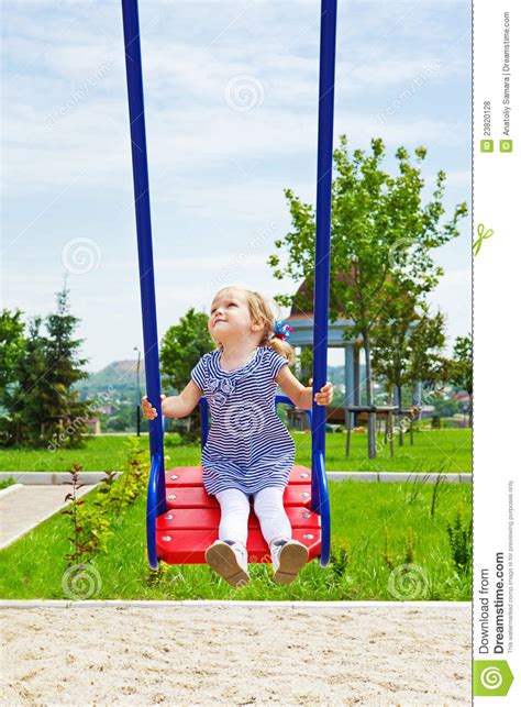kid on swing happy kid on a swing royalty free stock photos image