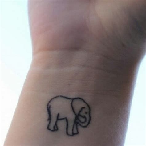 small animal tattoos pin tiny elephant on wrist on
