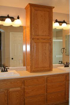 z completed bath storage cabinet w framed mirror on