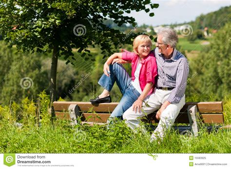 couple sitting on bench senior couple sitting on bench royalty free stock photo