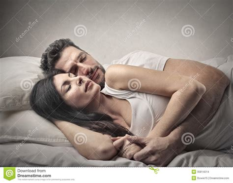 cuddling in bed couple sleeping stock images image 35814014