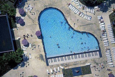 guitar shaped swimming pool let s swim and play piano vs guitar shaped swimming pool