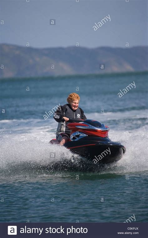 boat driving water skiing old person water skiing stock photos old person water