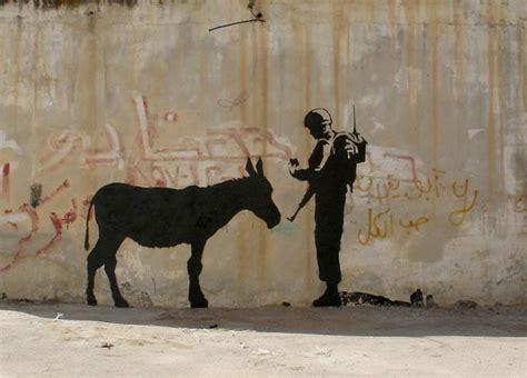 palestinian graffiti  banksys art vostok zapad