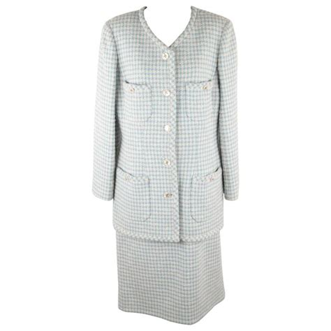 chanel boutique light blue tweed skirt suit collarless