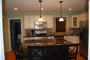 kitchen table or island anyone do away with their kitchen table and extend their island