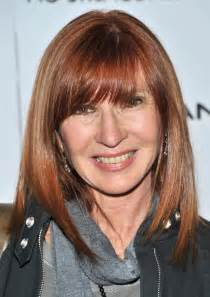 hairstyles with side swept bangs for 50 why long bangs could shave 5 years off your look