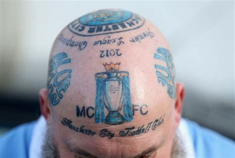 one middle aged manchester city supporter has club tattoos