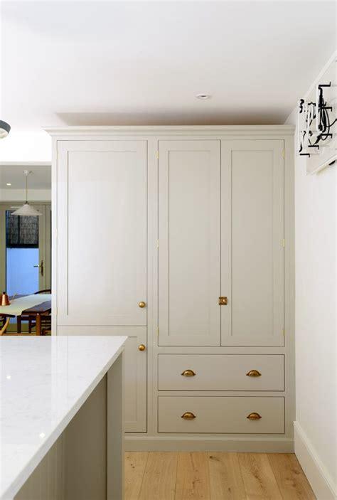 beautiful shaker pantry cupboard  integrated fridge