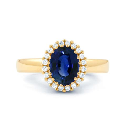 blue sapphire halo yellow gold ring boutique