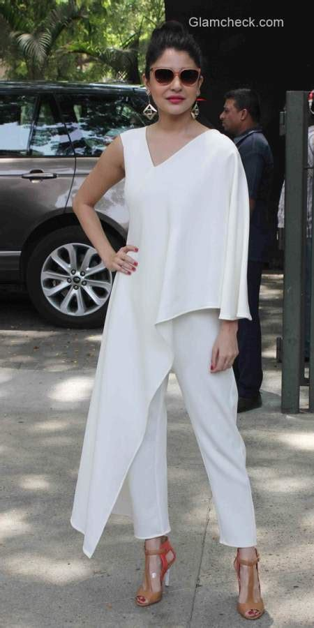 anushka sharma is slayin it in a jumpsuit as she poses anushka sharma in a white jumpsuit by bhaavya bhatnagar
