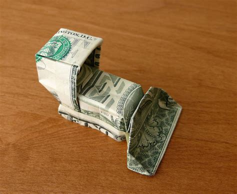 100 Dollar Bill Origami - dollar bill origami bulldozer by craigfoldsfives on deviantart